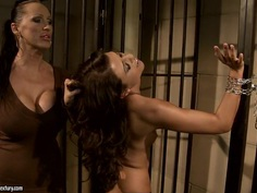 Mandy Bright chained a hot babe at the jail steel