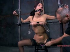 Dirty whore Lavender Rayne sucks on hard penis in BDSM act