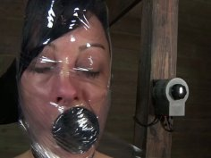 Black haired hoe Elise Graves gets her legs stretched and caned