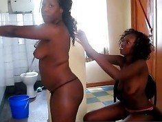 Horny ebony lesbians Kali and Oni loves fingering their pussies
