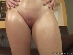 Rebecca Lane rubs her body with oil and later gives deepthroat blowjob
