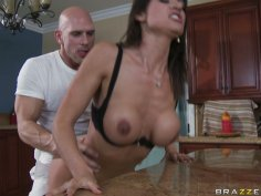Horny stud Johnny Sins enjoys sucking Franceska Jaimes' boobs and thrusts her from behind in a kitchen