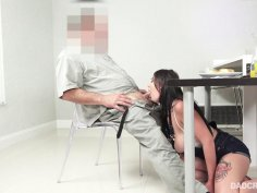 Slutty little bitch gives old fart blowjob under the table