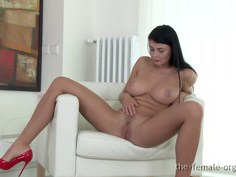 Sexy Lucy with big natural breasts masturbates