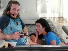 Adria Rae is sucking Brick Danger's cock as he playing video games