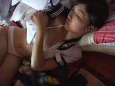Naive Japanese teen Noriko Kijima takes a bath in bikini