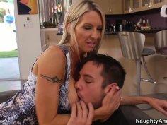 Cougar Emma Starr seduces a young stud and sucks his cock